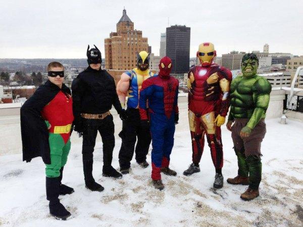 (L-R) Robin, Batman, Wolverine, Spiderman, Ironman and the Hulk prepare to propel down Akron Children's Hospital to wash windows.