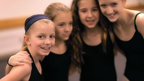 Katherine Schroeder (left) with her dance group.
