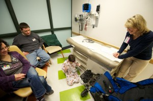 Child life specialist Michelle Peterson meets with the family to answer questions