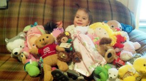 Bekah surrounded by her toys.