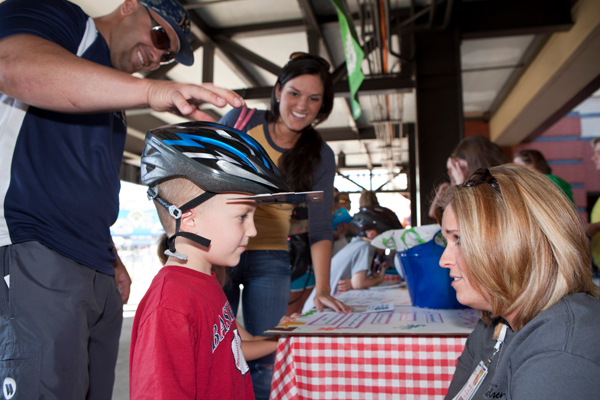 Becky Cobbs of Akron Children's School Health Services helped fit children with helmets.