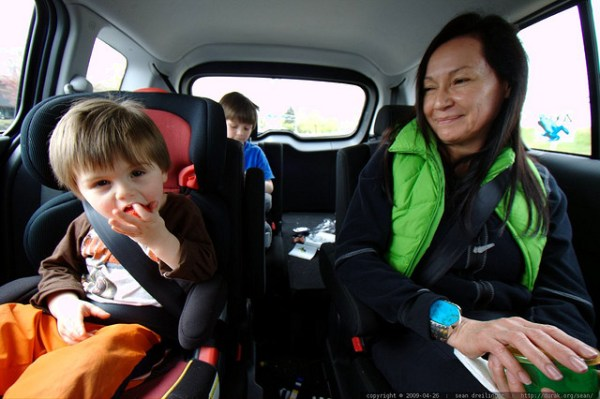 Eating strawberries in the car seat. CC / Flickr photo by  Sean Dreilinger.
