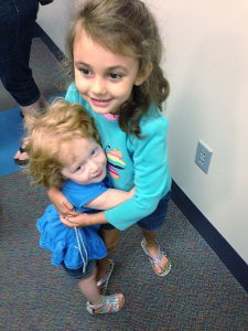 Lola Maxwell and Adysen Wills have fun playing while their moms socialize.