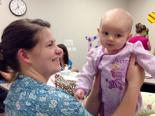 Dayna Potoczek gets a big smile from 3-month-old Esther.