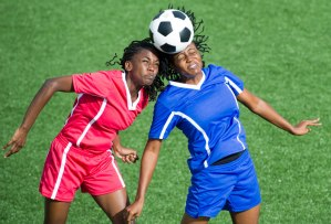 Controversial debate: When should soccer players begin to head the ball?
