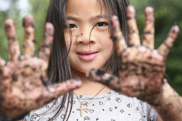 The Scoop on Dirt: Why a Little Mess May Prevent Allergies and Asthma in Kids