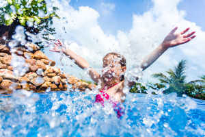 little girl splashing at dollywood splash country in Pigeon Forge