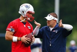 Tim Tebow with Patriots offensive coordinator Josh McDaniels
