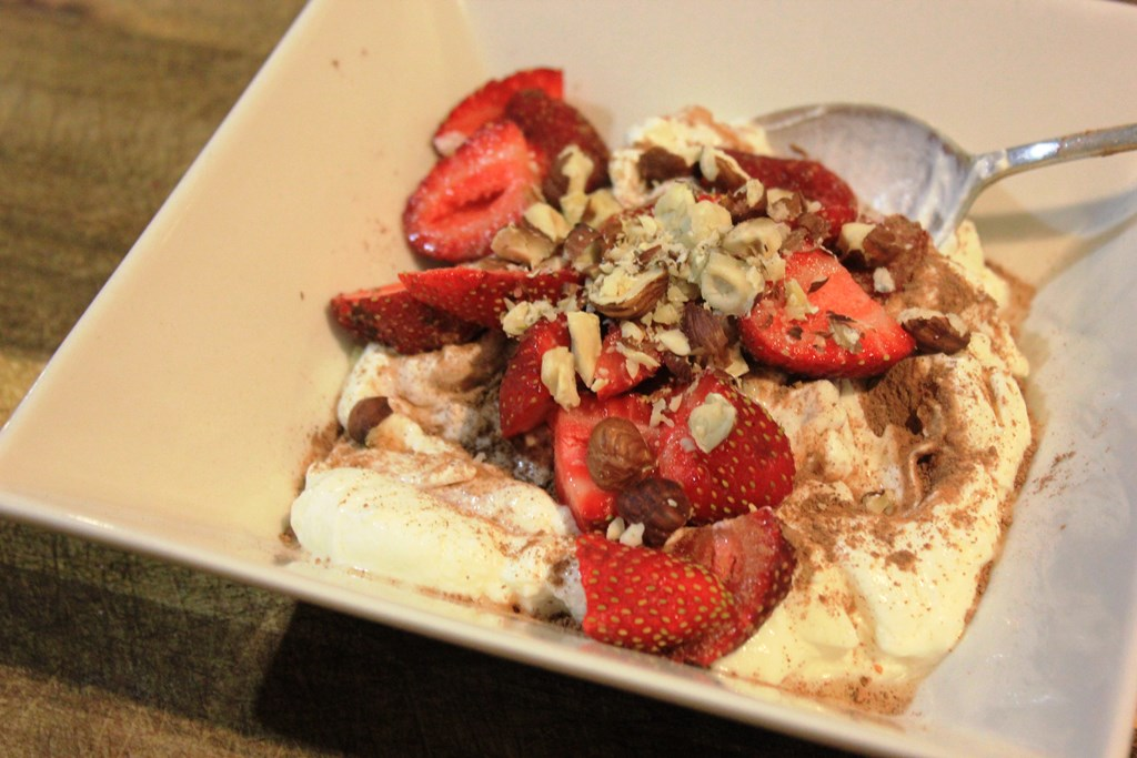 Desert: Greek yoghurt with strawberries, raw cacao powder and crushed hazelnuts