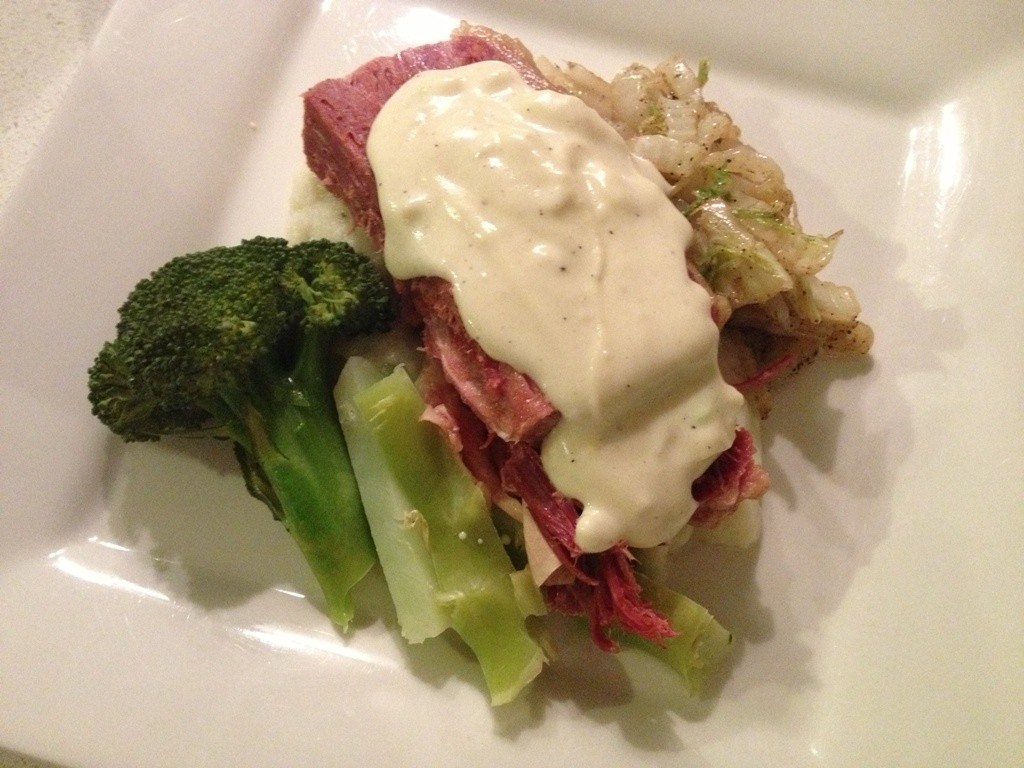 Corned beef silverside with cauliflower puree, cabbage, broccoli and cheesey white sauce