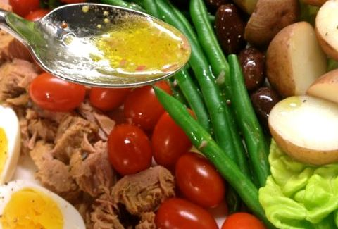 Dijon dressing over a Nicoise salad