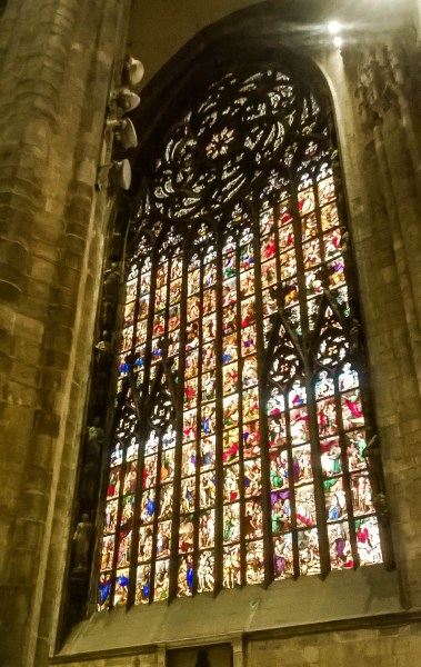Huge stained glass window inside the Milan Cathedral