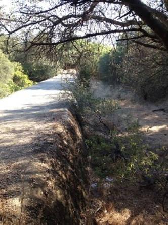Railroad bed and canal wall leading to Folsom Power House