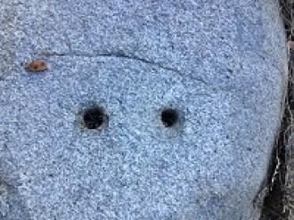 Drilled anchor holes in granite below Zantgraf mine.