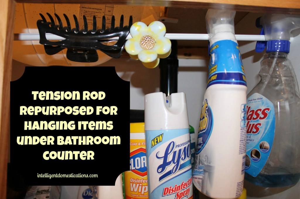 Repurposed tension rod for space saver under bathroom cabinet by intelligentdomestications.com