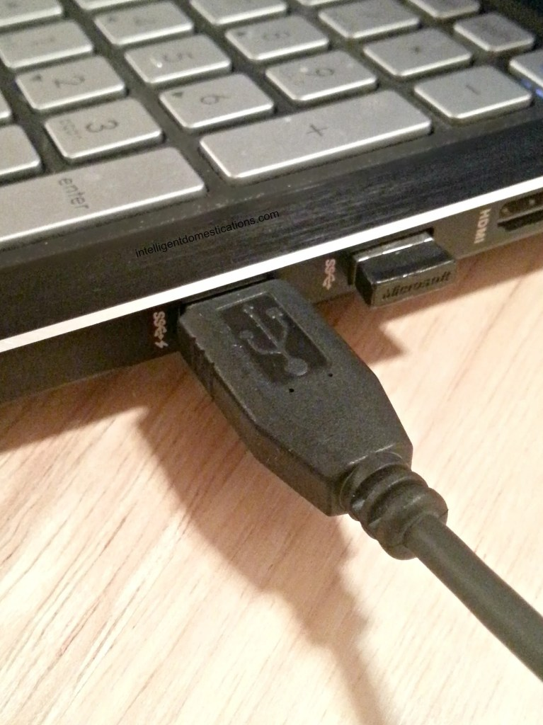Plug the cord into the port on your computer