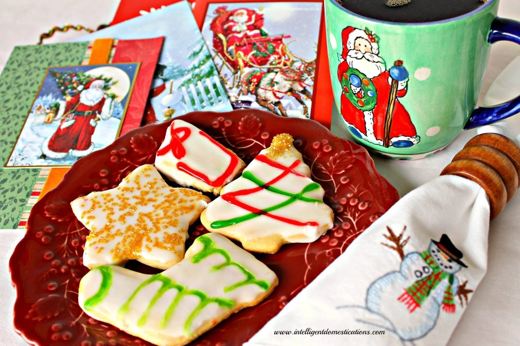 Old Fashioned Tea Cake Christmas Cookies  decorated for Christmas along with a cup of coffee and a stack of Christmas card make a nice treat.Find the recipe at www.intelligentdomestications.com