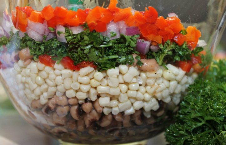 Black Eyed Pea Salsa layered in a glass bowl.www.intelligentdomestications.com