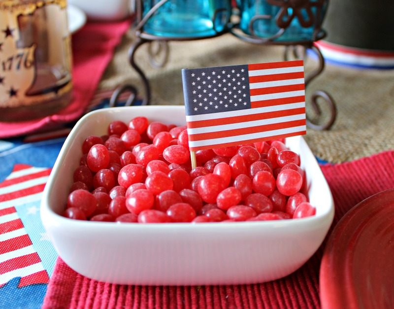 I added a small bowl of Red Hot's with a small flag pick to two table settings for fun