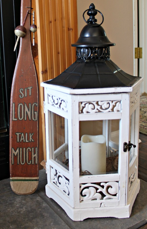 White wood with metal roof hex gazebo lantern used for fireplace decor