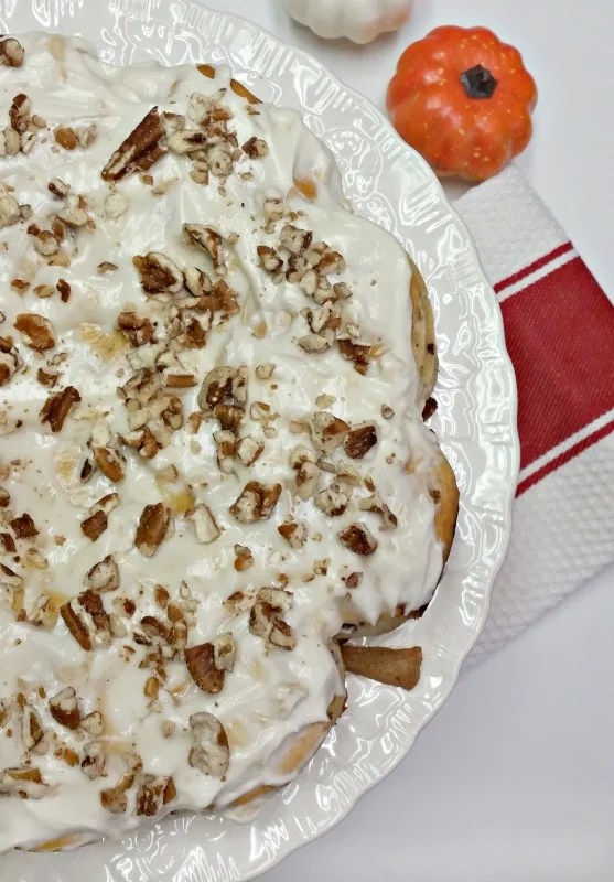 apple-cinnamon-roll-coffee-cake-with-apple-cream-cheese-icing-and-chopped-pecans-intelligentdomestications-com
