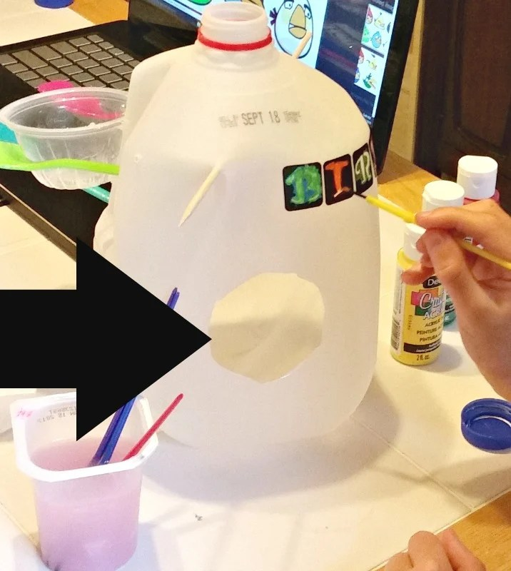 making-milk-jug-bird-houses-cut-a-hole-for-entry