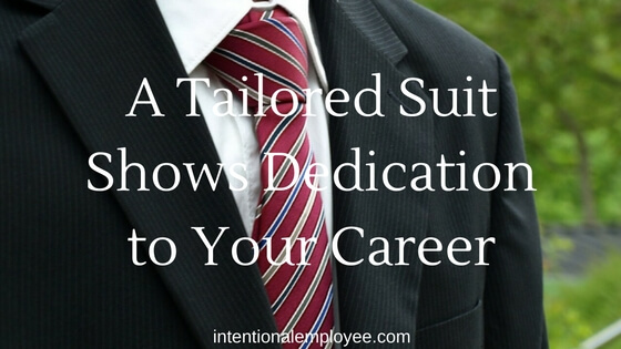 Buy a tailored suit to show your dedication