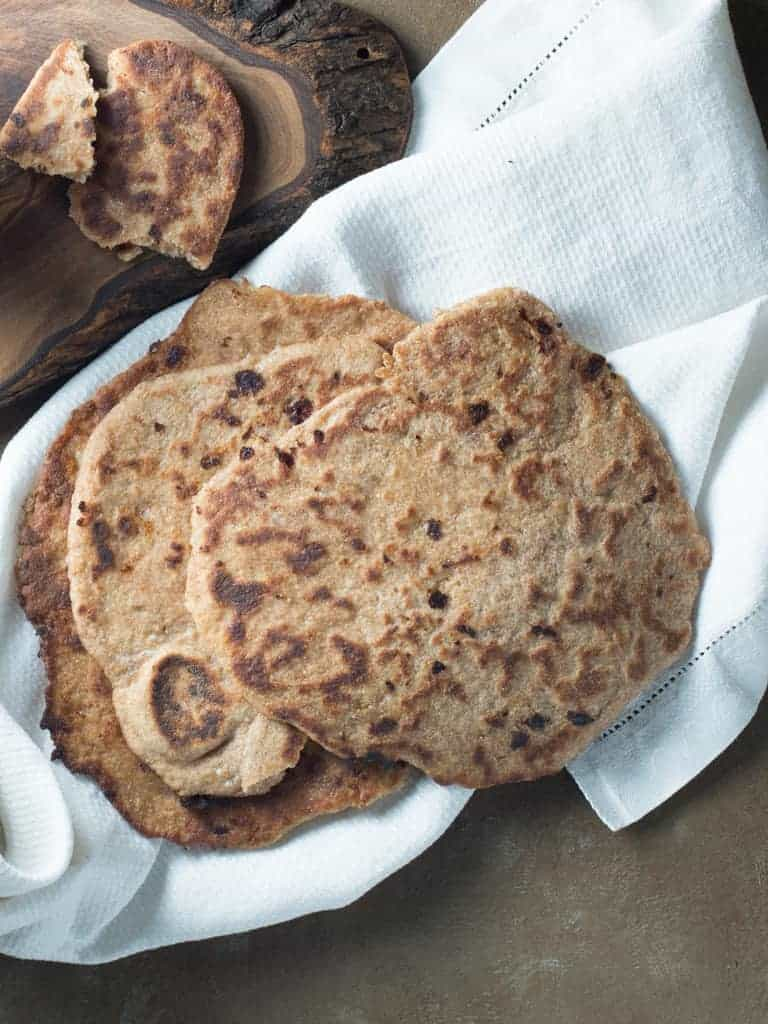 This soft chewy whole wheat naan recipe makes a healthy authentic old world bread.