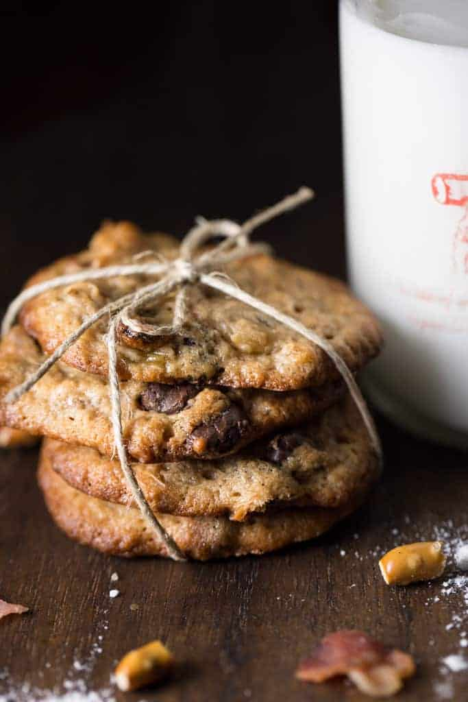 Bacon Pretzel Chocolate Chip Cookies are a  sweet chewy chocolate chip cookie  filled with little surprise bites of salty pretzels and bacon.    I would call these cookies the happy couple cookie, bacon and pretzels for the men and chocolate for the ladies. It's the best of both worlds all mixed up in  a gooey cookie goodness.