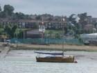 Pretty little clinker yacht outside Medway cruising club's premises