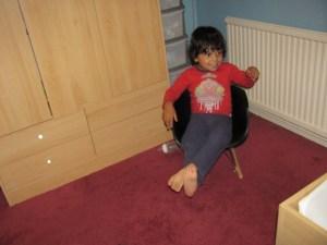 boy in rocking chair