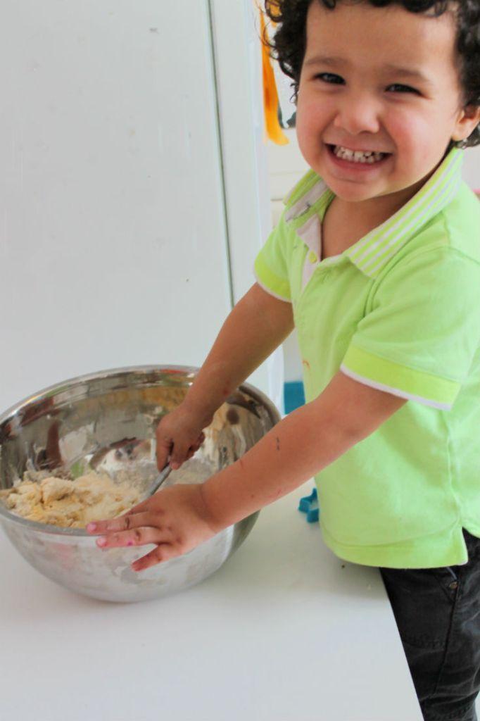 toddler making biscuits