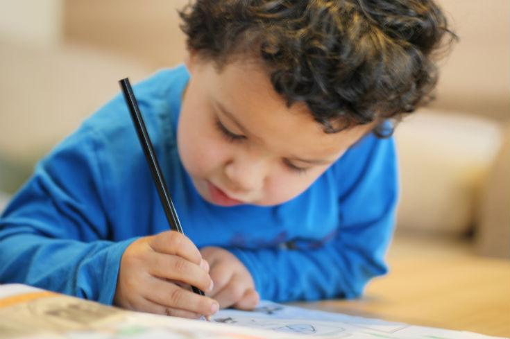 boy colouring dino supersaurus book