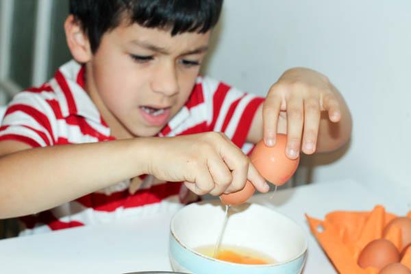 cracking eggs for scrambled eggs