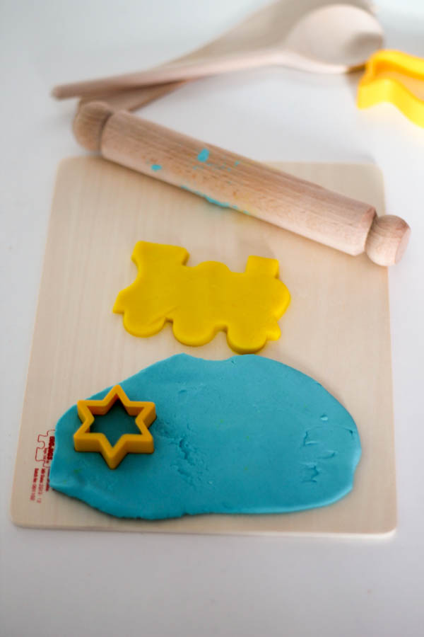 cutting shapes with playdough