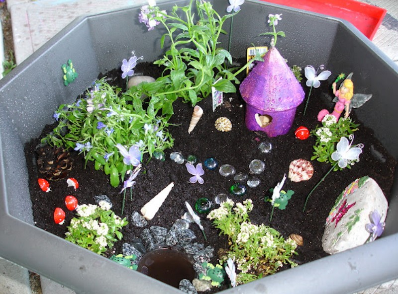 fairy garden with painted bird house from two big two little
