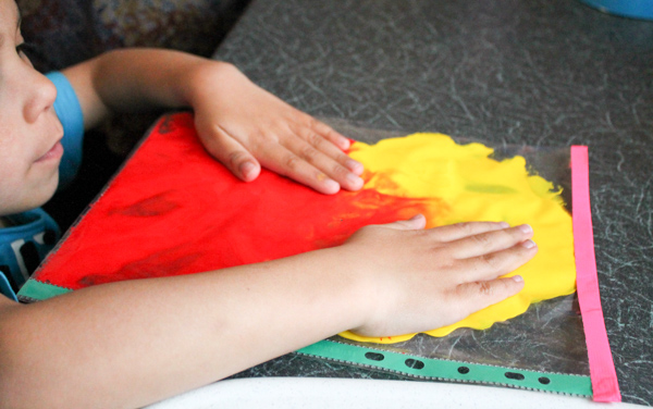 colour mixing with paint, red and yellow make orange
