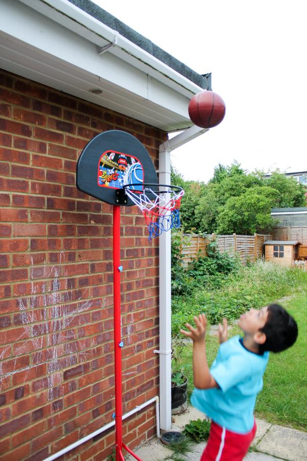 shooting basketball in the garden