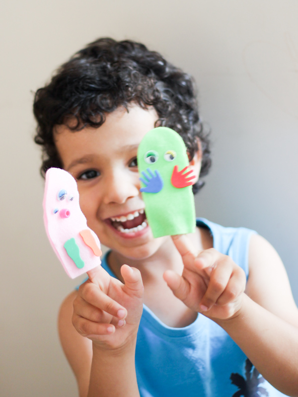 playing with monster finger puppets