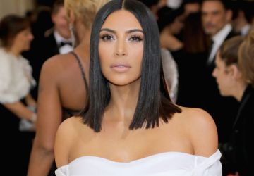 kim kardashians surrogate is reportedly three months pregnant