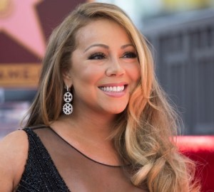 mariah carey signs to roc nation
