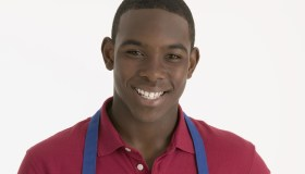 Boy smiling with an apron on