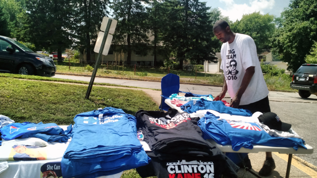 Kevin McCray, who's from Ohio, has been following the Clinton campaign selling T-shirts. Photo: Gavin Aronsen/Iowa Informer