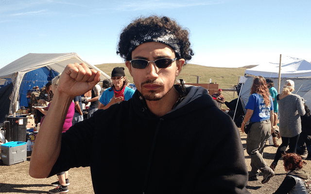 "David ""Flow"" Rodriguez, a water protector fighting the Dakota Access pipeline, at a camp on the frontlines of the resistance outside the Standing Rock Sioux Reservation in North Dakota last September. Photo: Gavin Aronsen/Iowa Informer"