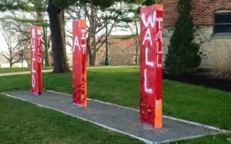 """""""Build a Wall. Build it Tall,"""" reads the writing on three posts at Cornell College on April 11, 2016. The slogans sparked controversy and were replaced with a painting that read, """"Free speech matters."""" Both paintings then were replaced with one that read, """"Free speech matters."""" Photo courtesy of Abby Castro"""