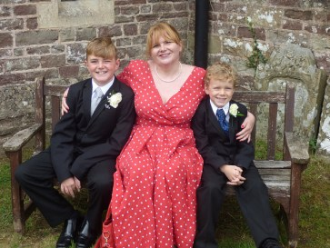 Me with my two sons at a wedding two days ago.