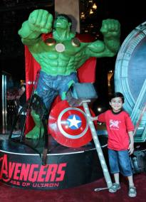 An excited kid posing with the life-sized Hulk figure at the premiere of Avengers 2 held at Arena Bahria Town Rawalpindi.