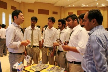Representatives of U.S. universities discussing U.S. study options with Pakistani students