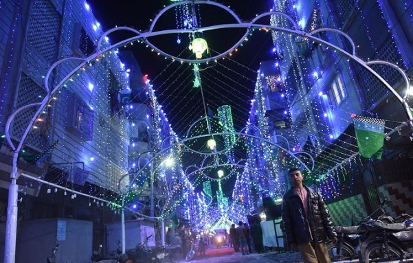 A Pakistani boy walks past a street decorated to celebrate the birthday of Prophet Mohammed (PBUH) in Karachi. Photo: AFP