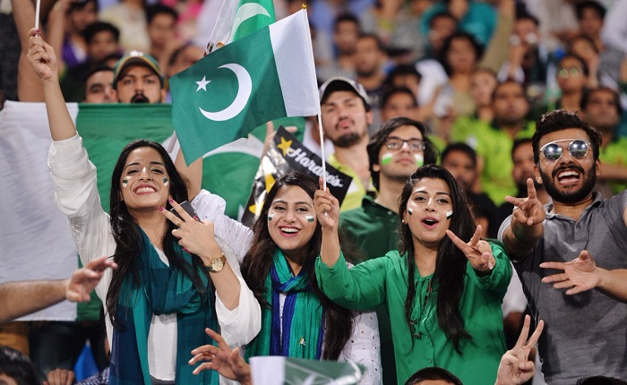 Pakistani spectators cheer as they watch the first Twenty20 international match between the World XI and Pakistan at the Gaddafi Cricket Stadium in Lahore on September 12, 2017. Photo: AFP